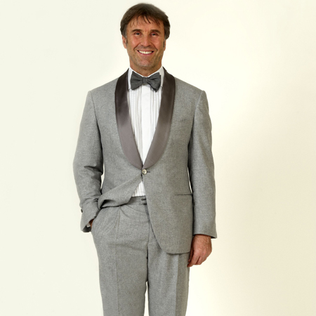 Cucinelli himself wearing his grey tuxedo.