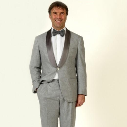 Cucinelli himself wearing his grey tuxedo.