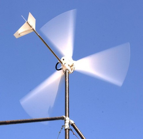 This wind turbine charges a 12 V battery to run 12 V appliances.