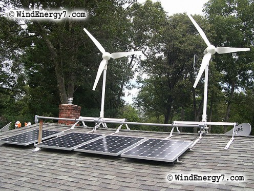 According to the manufacturer, this system provides wind power in the winter when wind is strongest and solar power in the summer.  However, with this many trees around the site, it is questionable if the system works like it should.