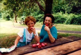 My mother and niece enjoying some of the wild apples (also wild blackberries) found near Bridal Veil Falls