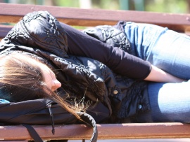 Woman Asleep on Bench - Courtesy of www.Photo8.com