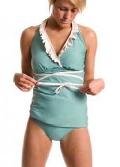 This ultra feminine, sea-foam ruffled halter-style tankini is a definite eye catcher!