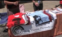 Full Circle Thread displays their line of children-inspired shirts at a Cincinnati Street Fair.