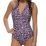 This adorable purple halter-style one-piece bathing suit is ideal for modesty and fashion.