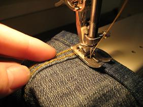 Machine sewing (especially with a professional-quality machine) will give you the most just-from-the-factory look, but this can be done by hand.