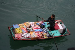 Vendors approach the Halong Bay Cruise Ships