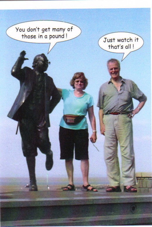 fooling about in Morecambe, not on tax payers money! -though i think the statue is!  (Eric Morecambe, much loved British comedian with day trippers)