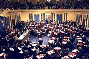 The impeachment trial of President Bill Clinton in 1999, Chief Justice William H. Rehnquist presiding. The House managers are seated beside the quarter-circular tables on the left and the president's personal counsel on the right, much in the fashion