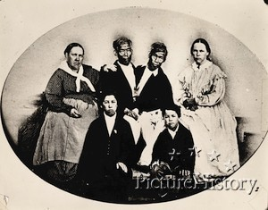 Back left: Sarah seated next to husband Eng and son Albert (Front-left);  Adelaide (back-right) seated next to husband Chang with son Patrick Henry (front)