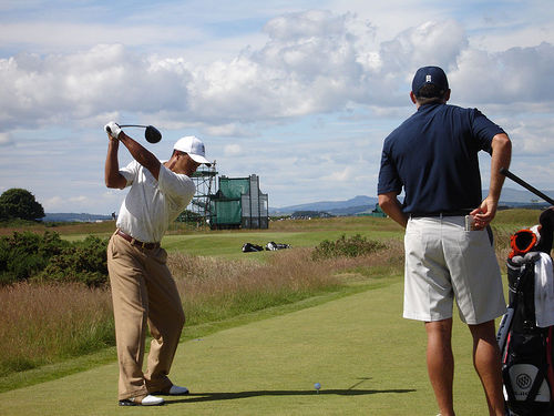 Take a look at Tiger, shown here at the apex of his swing, after he's folded his back elbow.