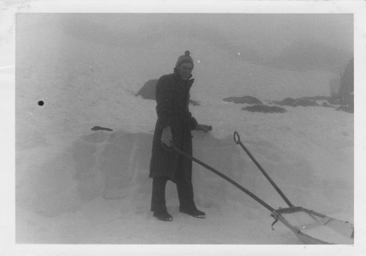 Your truly standing next to thick snow drift, Mt. Kosiosco September 1962