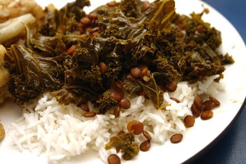 lemon lentils with kale, cumin, and turmeric over rice