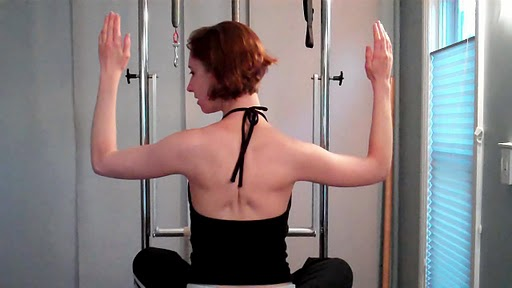 Draw your shoulder blades down and together...