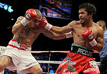 Pacquiao throws a right hook at Cotto