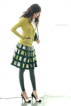 The green and mustard hues of this outfit brighten an otherwise chilly ensemble.