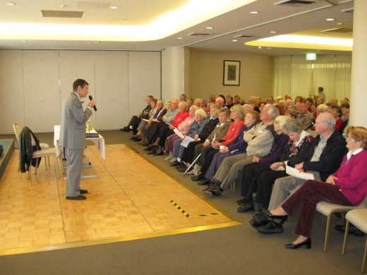 The writer addressing a 'retiree' audience at a Returned Serviceman's Club in Sydney, Australia