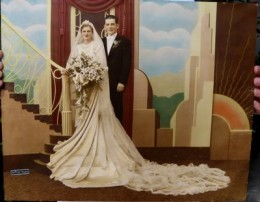 Hand-tinted wedding photo from the 1920s. The ice blue and light green shades are nicely anchored by the deeper hues.