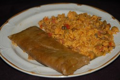 A green pastele served with Arroz con Gandules,It doesn't get more Puerto Rican than that!