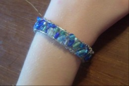 Cuff bracelet made with a variety of sea glass, a wire frame, and wire.
