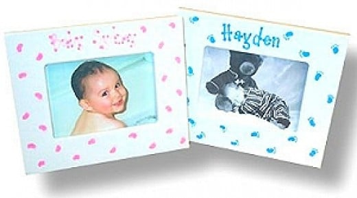 Pair your baby photos with personalized picture frames. These were found at www.baby-gifts-gift-baskets.com