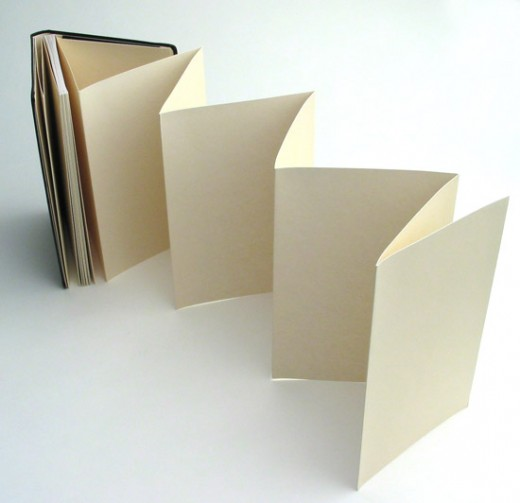 60 plain zig-zagging, thick pages Dimensions: (9x14 cm)