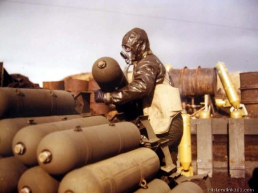 Here soldiers prepare gas for release on enemy combatants.