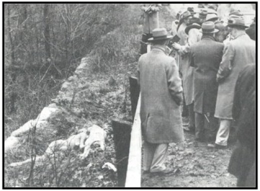 The Grimes Sisters bodies were found here at this location on German Church Road. Their bodies can be seen over the guard rail to the left.