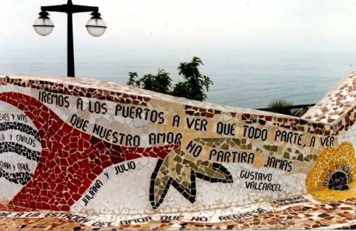 Mosaic poems along the wall on the edge of Parque del Amor