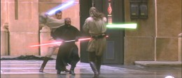 Qui-Gon Jinn and Obi-Wan Kenobi battle Darth Maul on Naboo.