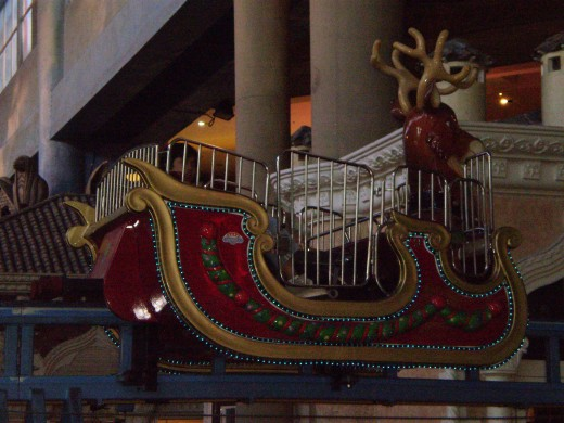 "Take a relaxing ride on this ""reindeer"" and get a nice view of the indoor theme park."