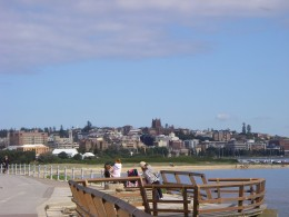 View of the city of Newcastle from a waterfront walkway