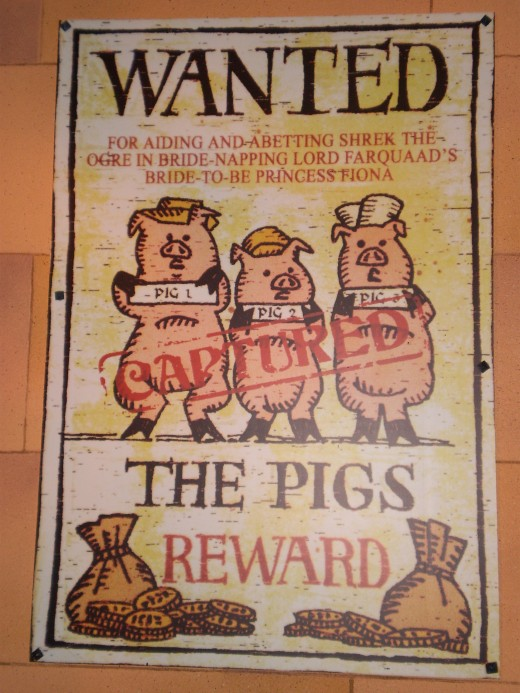 A poster for the Shrek 4-D Adventure featuring the 3 Little Pigs.