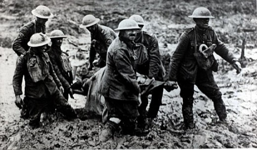 Soldiers helping the wounded at ypres, typical of the conditions!