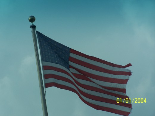A large flag on a tall flag pole.