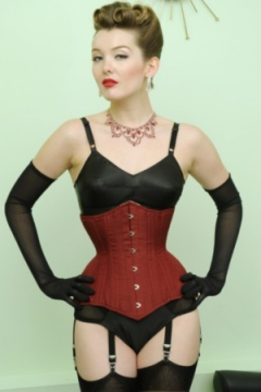 "Long line underbust corset which really cinches that waist due to goring at the hip. The shaped, lower hipline really flatters. Measures 13.25"" length along front busk"