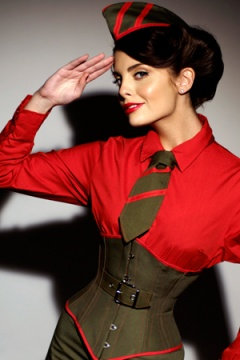 Velda Lauder Khaki Underbust Corset This bold corset is made using drilled cotton and features a red trim. Photography by Row Howe.