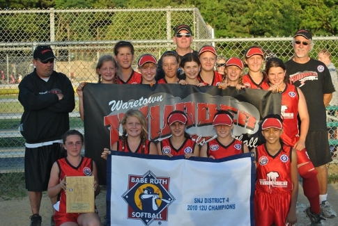 Darren Mooney, left, stands with his Waretown Thunder 12-U squad, which copped the league's first-ever District crown in that age group.