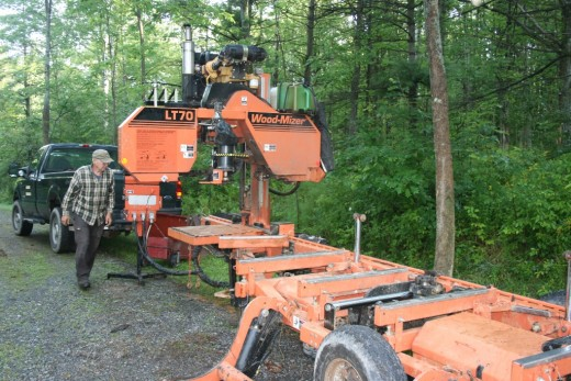 Setting up the portable sawmill in my driveway.
