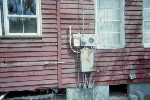 Exterior boards were painted red during mid century of the 1900's. All electrical was updated 2006.