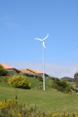 A commercial home windmill in a semi-rural setting.