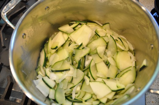 Slice zucchini and onion. Cook gently.