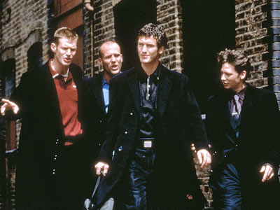 Jason Flemyng, Jason Statham, Nick Moran and Dexter Fletcher as four coniving friends in Lock Stock and Two Smoking Barrels.
