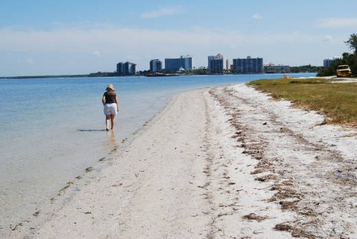 Walk the causeway beach with the Fort Myers high rises in the background.