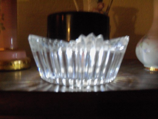 Solar light on cut glass candle holder on the piano.