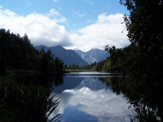 Lake Matheson and cloud-covered Mt. Cook, the tallest mountain in New Zealand