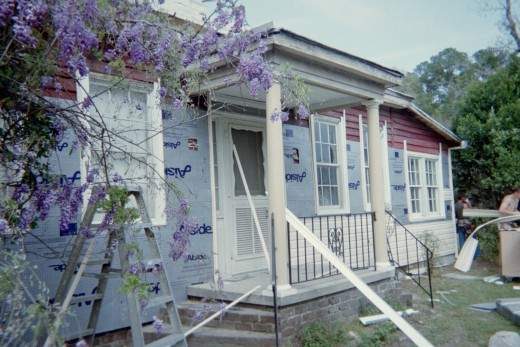 The small concrete porch was added in the 1960's after the wrap around porch was removed.