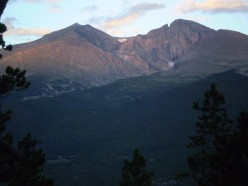 A benign view of Longs Peak's east aspect from Twin Sisters Peaks. Mount Meeker is the peak on the left.