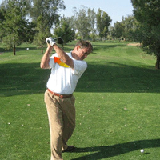 More of a bend in the left elbow at the top of the backswing