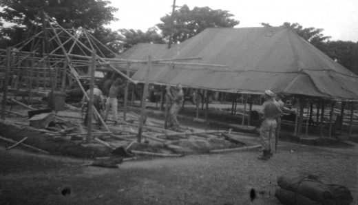 U.S. Army troops setting up camp in Philippine Islands during World War II